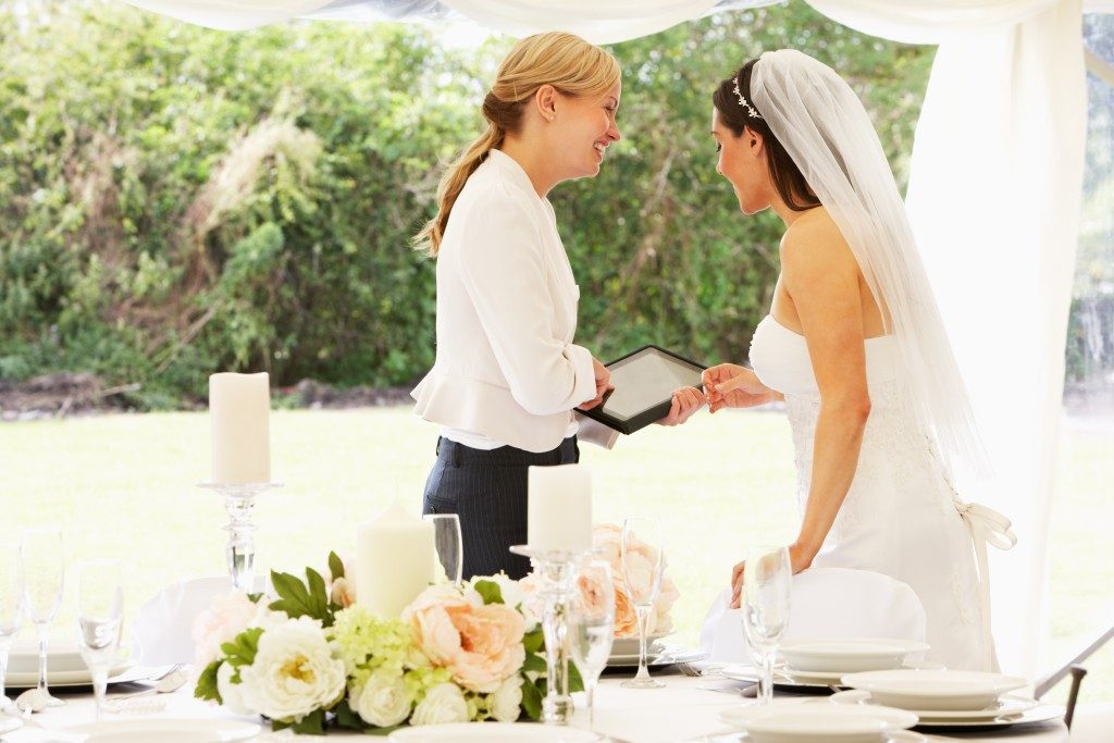 bride with the wedding planner