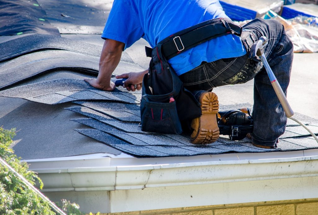 man installing ion roof