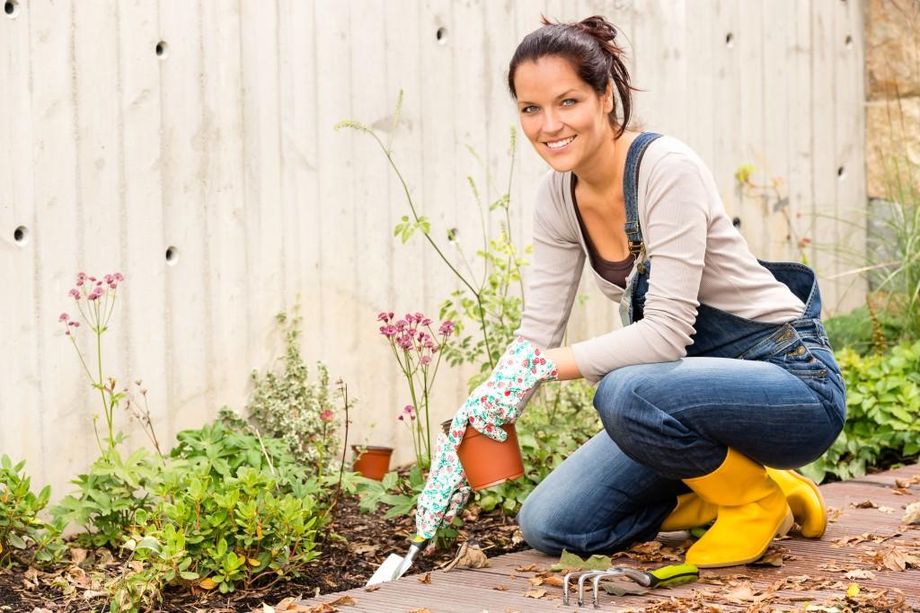 Female caring for her backyard garden