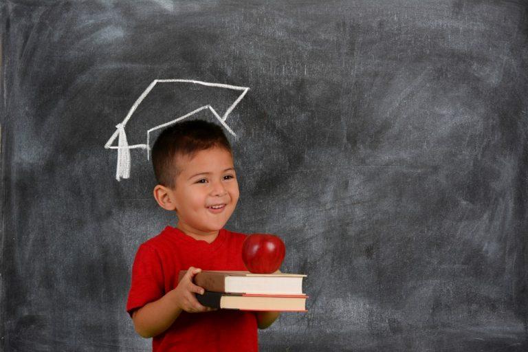 kid holding books