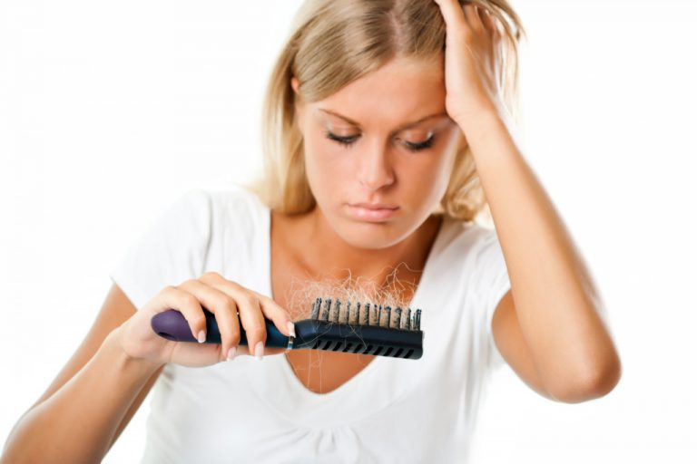 woman suffering from hair loss