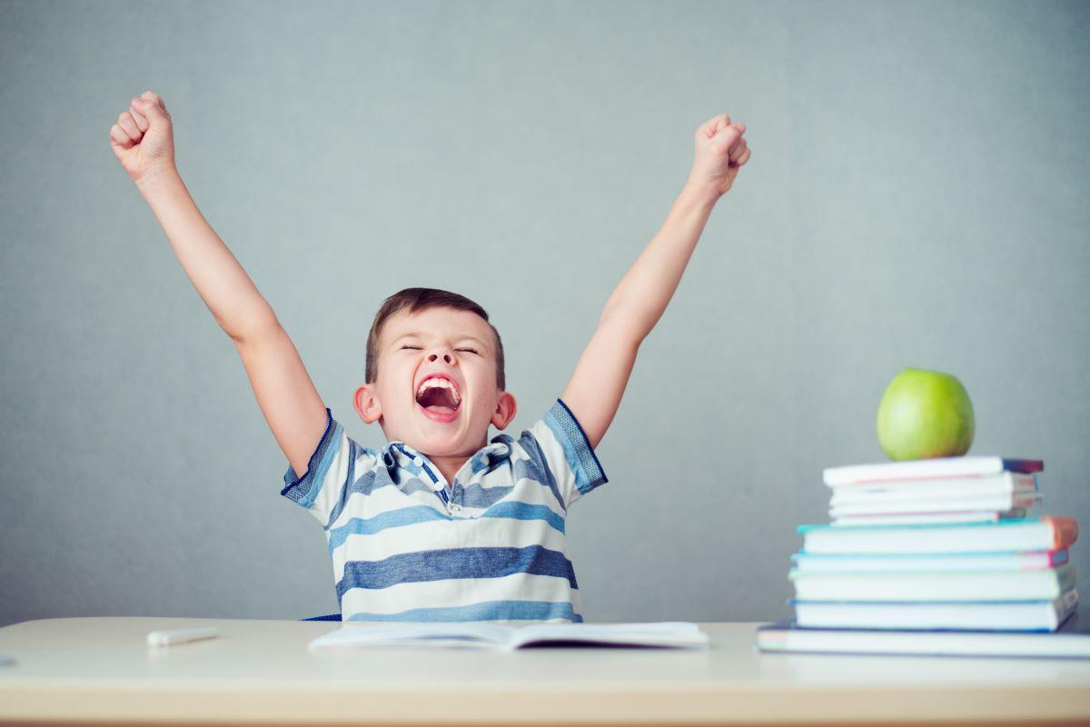 child yawning while studying
