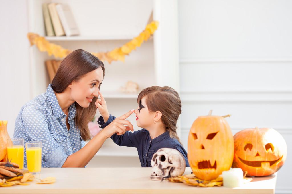 parent and child celebrating halloween